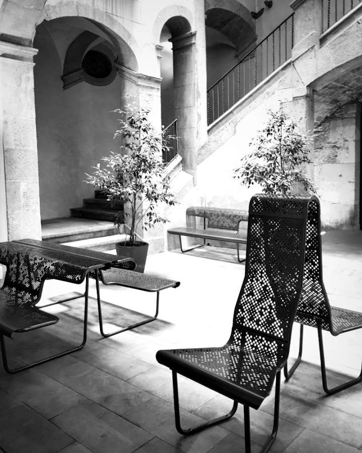EMPTY chairs in Barcelona courtyard